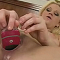 Alex stretches her pussy with phone