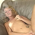 Blonde whore sucks down a cigar and cums on the couch