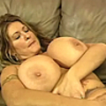 Slut with giant tits rips her pantyhose and masturbates
