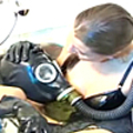 Female slave in gas mask finger-fucked and whipped