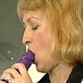Horny housewive fucks herself with purple dildo