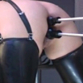 Mistress gives two female slaves double dildo-fuck