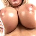 A MILF playing with her oiled monster tits
