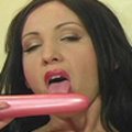 Watch this brunette babe fill her pussy with her big toy