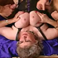 Slutty grandma enjoys two young cocks and a dildo