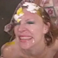 Spunked redhead gets an egg on her face